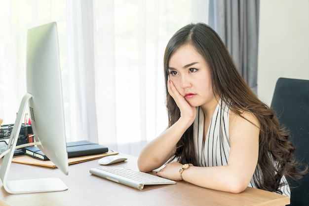 Seriously asian woman in office