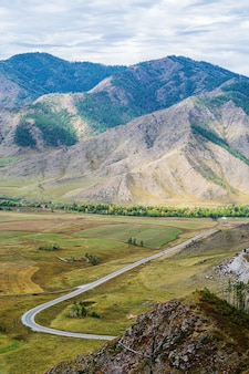 Serpentine mountain road view of the chuysky tract from chiketaman pass altai mountains russia