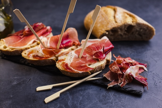 Serrano ham appetizer with toasted bread