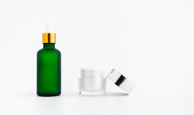 Serum bottle cream, mockup of beauty product brand.