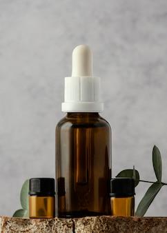 Serum bottle and plant arrangement