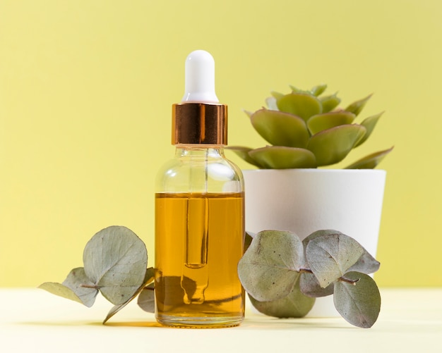 Serum bottle with potted plant