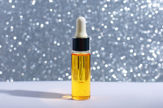 Serum skin care cosmetics on light