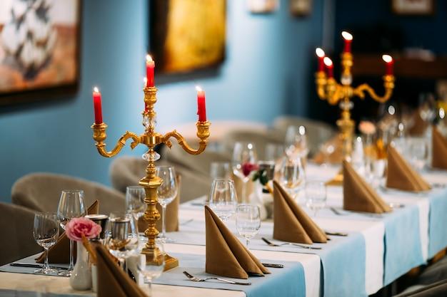 Served banquet table candelabrum glasses napkins