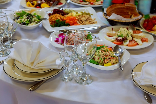 Served for banquet table. wine glasses with napkins, glasses and salads.