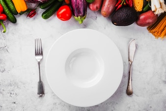 Served empty plate and ripe vegetables