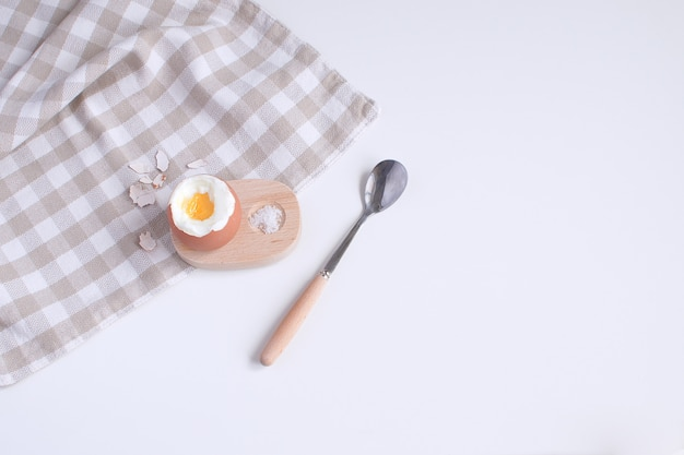 Served table for breakfast boild egg in wooden egg cup