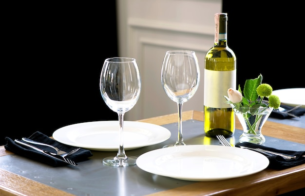 Served table in restaurant, focus on near glass and plate