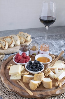Served table - wine appetizer, cheese assortment