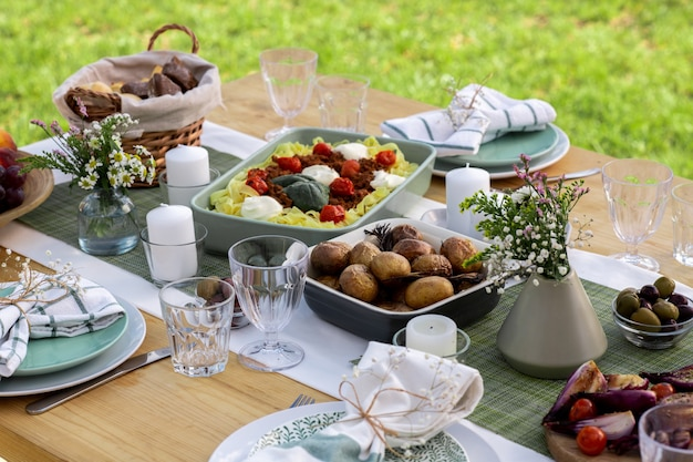 Served table with variety of homemade food prepared for lunch