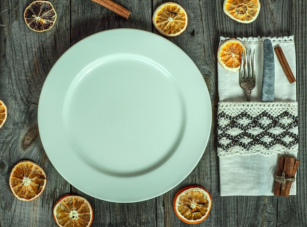 Served white empty plate on a gray wooden surface