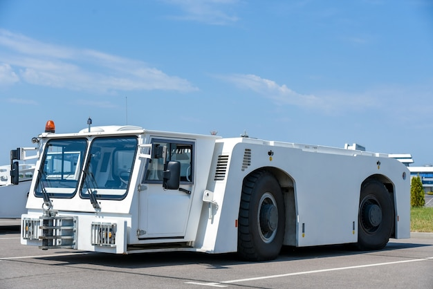 Service car, airfield tractor, airport, passenger service.