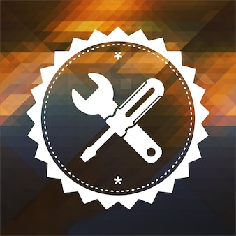 Service concept - crossed screwdriver and wrench. retro label design. hipster background made of triangles, color flow effect.