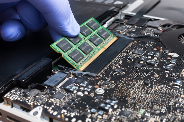 Service engineer install new ram memory chips to the laptop