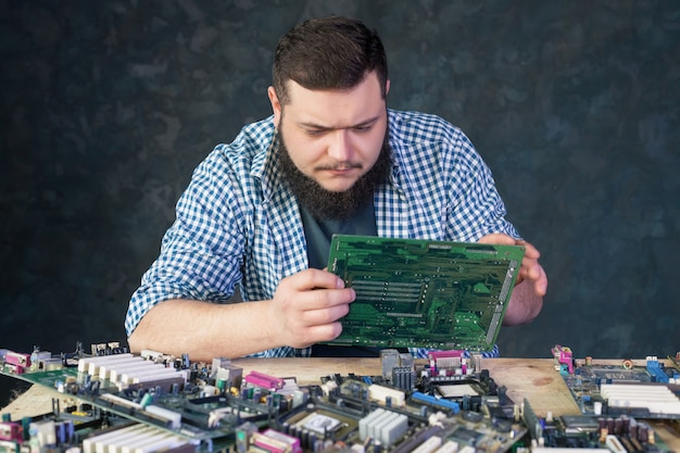 Service engineer work with broken pc hardware. computer electronic components repairing technology