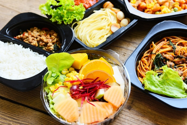 Service food order delivery spaghetti rice and fruit on food box, take away boxes package