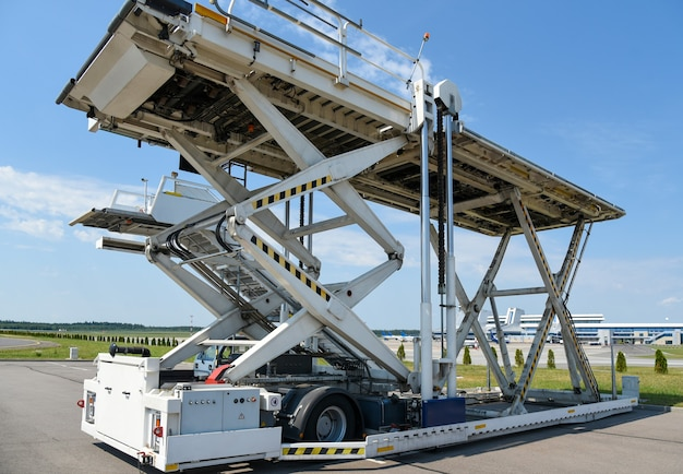 Service vehicle, aircraft cargo loader, airport, passenger service.