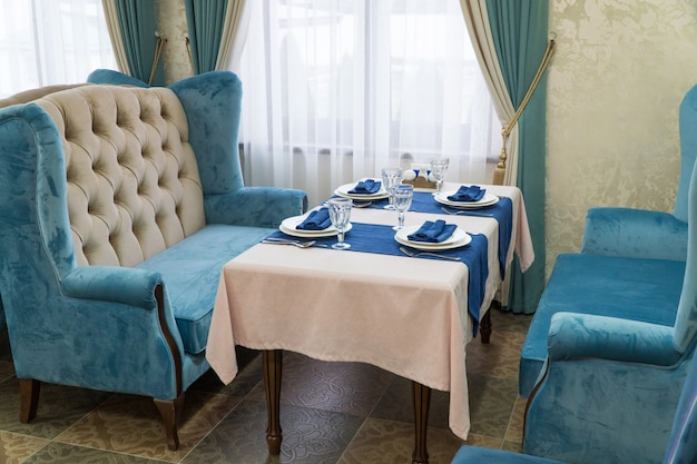 Serving banquet table in a luxurious restaurant in blue and light style