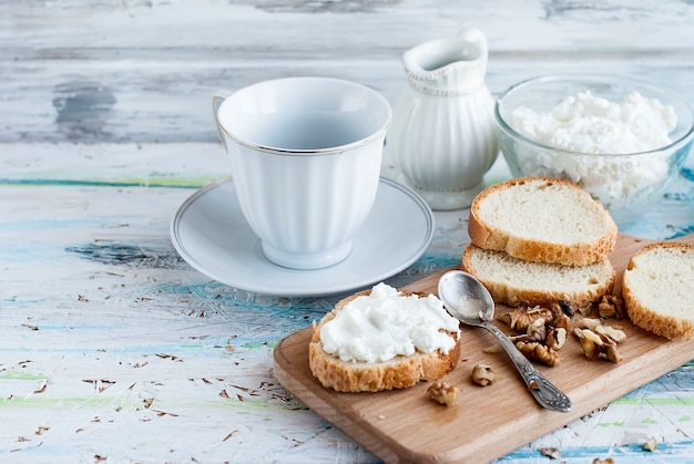 Serving breakfast sandwiches with ricotta, walnuts and honey