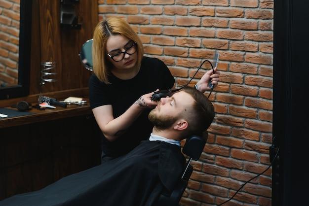 Serving client in barbershop.