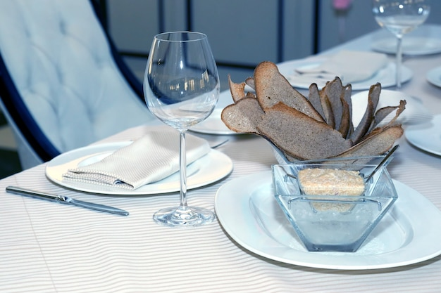 Serving dishes on the table in the restaurant. tableware
