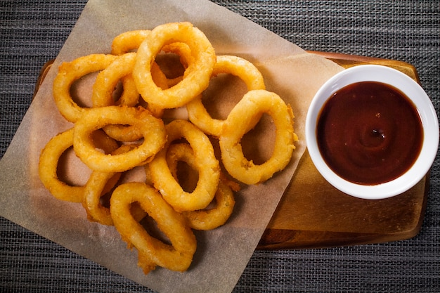 Serving of onion rings with ketchup