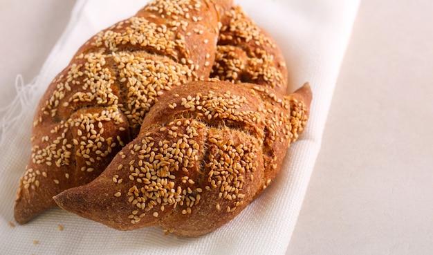 Sesame braid buns on textile on stone table