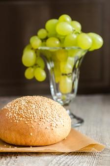 Sesame bun and bunch of grapes