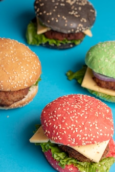 Sesame buns for pink and yellow hamburgers