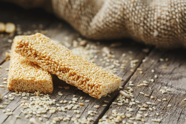Sesame seed casinos with burlap cloth. country style. delicious sweets from seeds of sunflower, sesame and peanuts, covered with shiny glaze