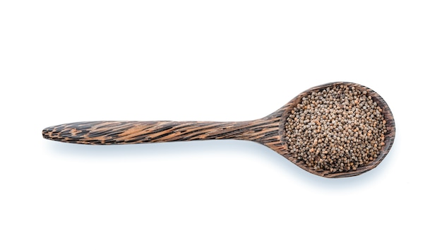 Sesame in wood spoon isolated on white