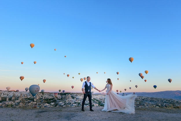 Session wedding couple in cappadocia turkey with hot air balloons