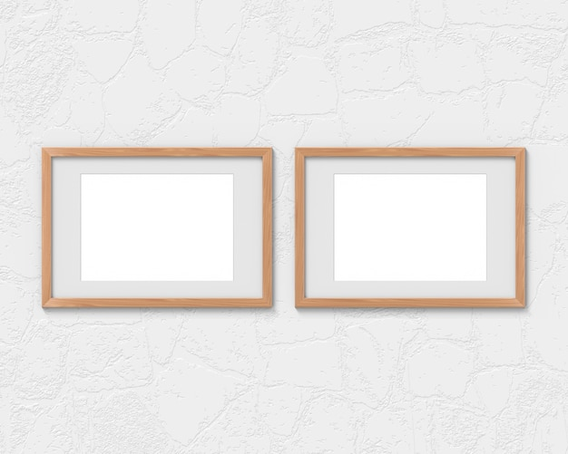 Set of 2 horizontal wooden frames with a border hanging on the wall. 3d rendering.