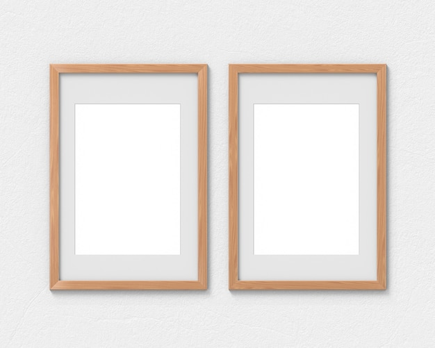 Set of 2 vertical wooden frames mockup with a border hanging on the wall. empty base for picture or text. 3d rendering.