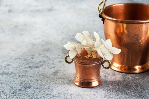 Set of 3 copper miniatures on concrete background