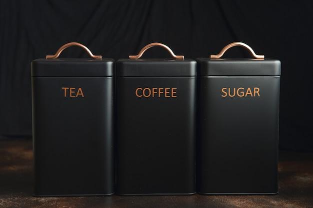 Set of 3 storage tins for housing teas, coffee and sugar.