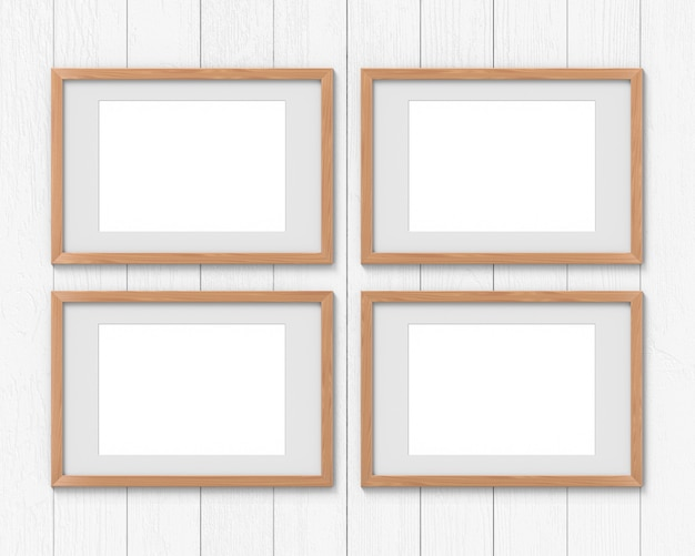 Set of 4 horizontal wooden frames with a border hanging on the wall. 3d rendering.