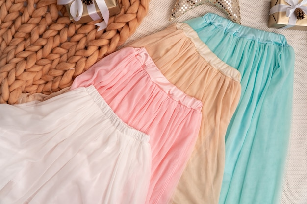 Set of 4 skirts made of fabric in delicate tones.