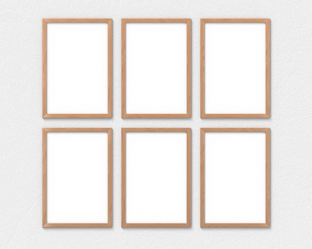 Set of 6 vertical wooden frames with a border hanging on the wall. 3d rendering.