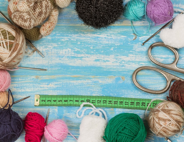 Set of accessories for knitting with a measuring tape background