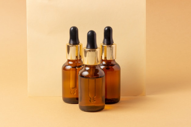 A set of amber bottles for essential oils and cosmetics. glass bottle. dropper, spray bottle