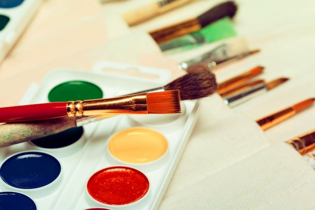 Set of art paint brushes with watercolors