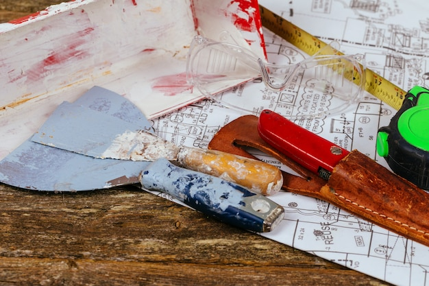 Set of assorted plaster tools and spatula on construction and renovation concept.