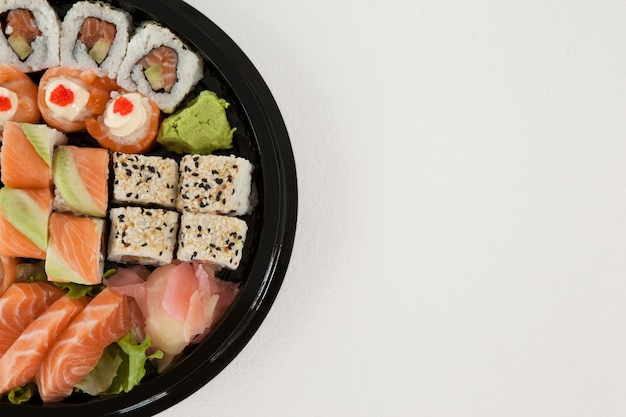 Set of assorted sushi kept in a round black box