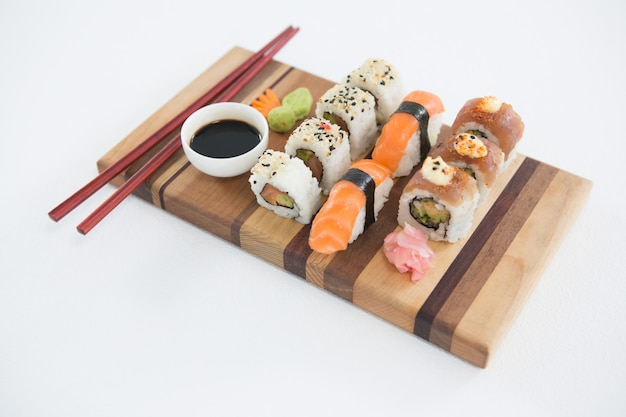 Set of assorted sushi served on wooden tray