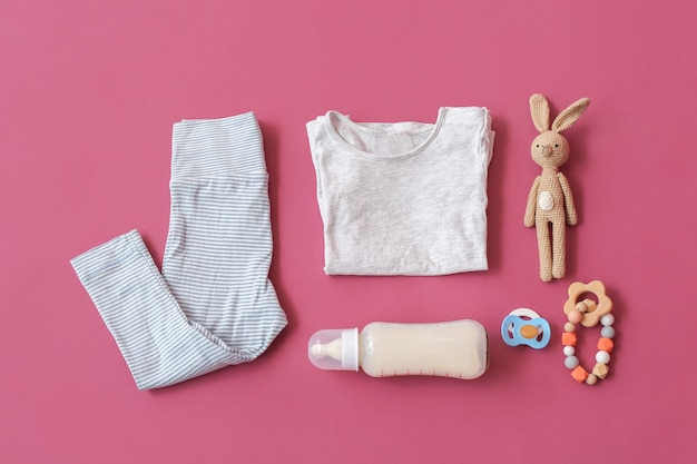 Set of baby accessories on color