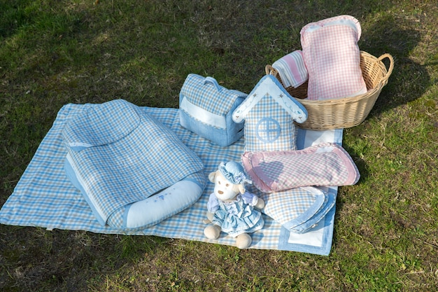 Set of baby clothes for newborn on grass