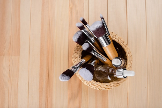 Set of bamboo make-up brushes, shot on abstract background. grouped together . top horizontal view copyspace sckin care and make up concept.