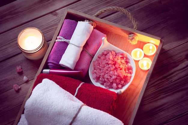 Set of bathhouse accessories for spa in low-key lighting