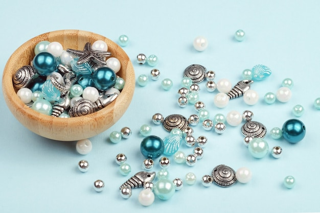 A set of beads for making necklaces. various forms, marine subjects